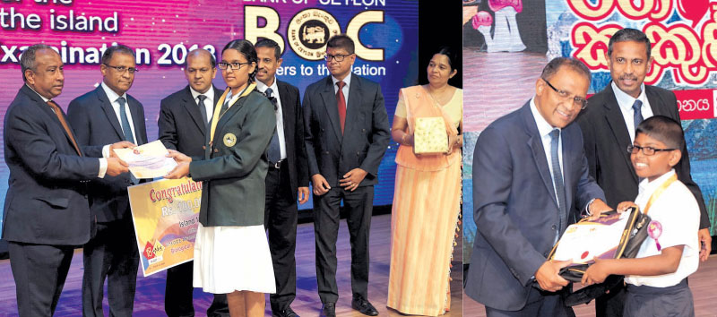 The Bank of Ceylon's Chairman, Ronald C. Perera and CEO and General Manager Senarath Bandara handing a scholarship offer letter, certificate and the Gold Medal to a student. CFO and DGM Corporate and Offshore Russel Fonseka, DGM Sales and Channel Management C. Amarasinghe, CMO Dr. Indunil Liyanage and AGM Marketing riyanthi Wijesekera are also in the picture.