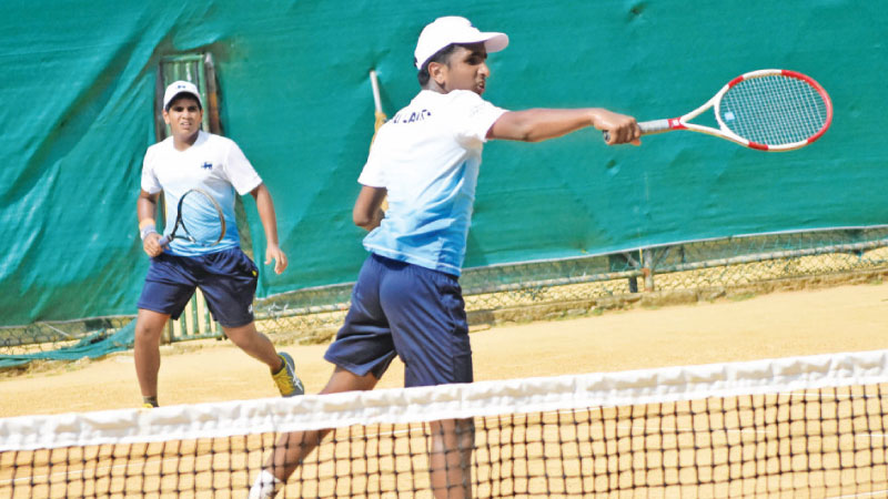 Dhilvan Herath and Chathurya Nilaweera in action during the doubles match against Vietnam at SLTA courts.