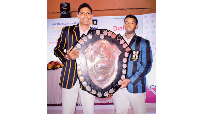 Rival captains Kavindu Madarasinghe of Royal and Sithara Hapuhinna of S Thomas' with the D. S. Senanayake Memorial Shield. Picture by Herbert Perera