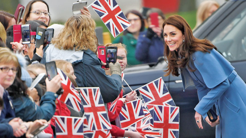 Britain's Catherine, Duchess of Cambridge greets wellwishers as she arrives in Ballymena, Northern Ireland