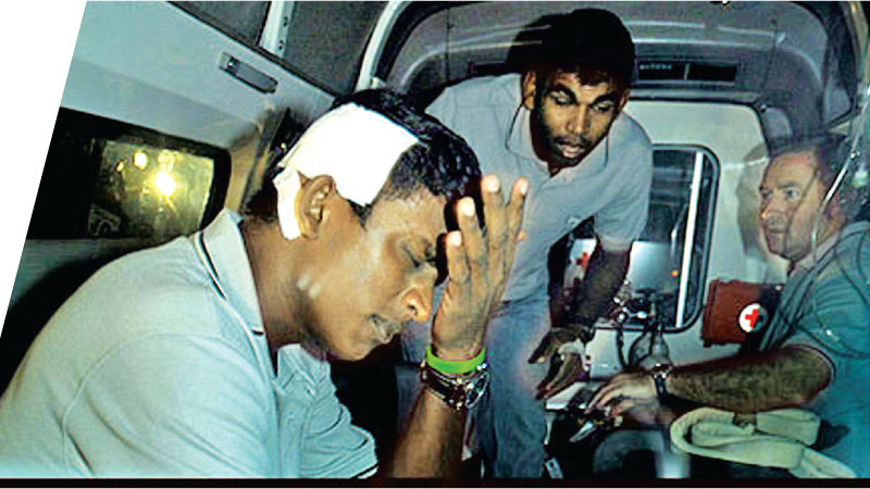 Casualty Ajantha Mendis (head in bandage) and Tillakaratne Dilshan.