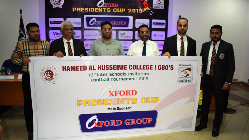 Chairman of Oxford Group Imthiyaz Farook (third from right) handing over the sponsorship cheque to Group of 80's President of Hameed Al Husseinie Faizal Buhari (second from right). Also in the picture are from left Managing Director of Oxford Group Hifaz Farook, Principal of Hameed Al Husseinie A.K.T. Adahan, Managing Director of Oxford Group Roshan Farook and General Secretary of Group of 80's Fazmin Faiz. Picture by Herbert Perera