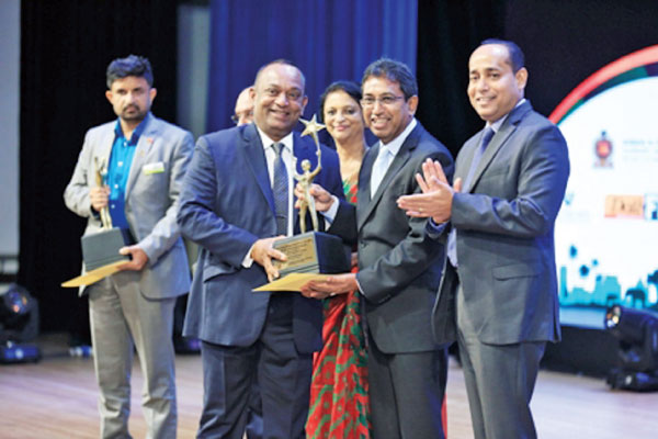 Three Sinha Group of Companies Managing Director Manjula Ariyakumara receives the Gold Awards.