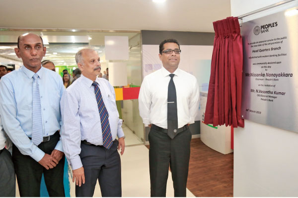 People's Bank Chairman Nissanka Nanayakkara opens the re-furbished branch while CEO and G.M.N. Vasantha Kumar looks on.