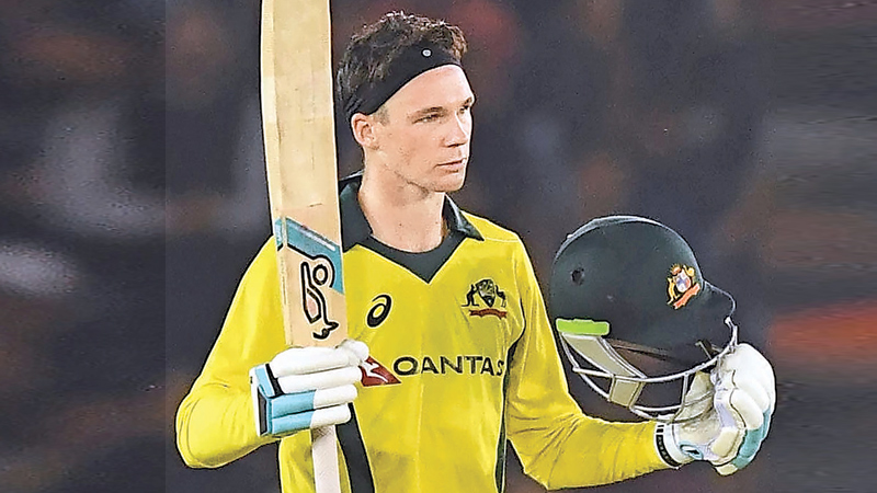 Australia cricketer Peter Handscomb raises his bat to celebrate his century during the fourth one-day international (ODI) cricket match at the Punjab Cricket Association Stadium in Mohali on Sunday. AFP