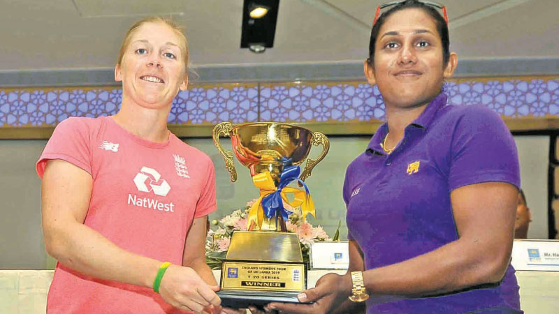 Captains Heather Knight (England Women) and Chamari Atapattu (Sri Lanka Women) pose with the trophy that will be awarded to the winner of the three-match ODI series.