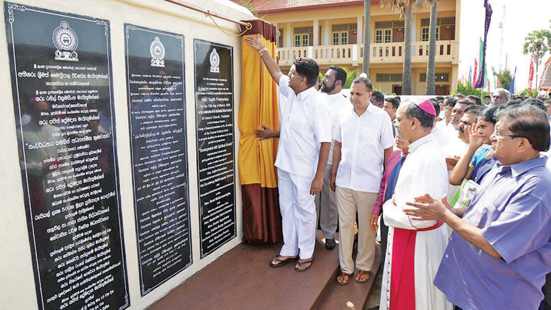 Housing, Construction and Cultural Affairs Minister Sajith Premadasa, Chilaw Bishop Rt.Rev Valence Mendis and State Minister Niroshan Perera laying the foundation for a Residential Retreat Centre at St. Anne's Church in Thalawila.