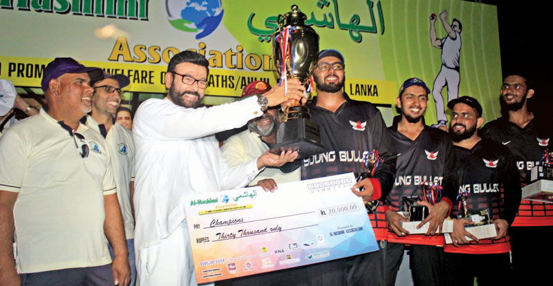 Sadik Mowlana, captain of Young Bullets team receiving the champion trophy and Rs. 30,000 cash award from chief guest State Minister of Social Empowerment Ali Zahir Mowlana. President Rizvi Moulana, Vice President Shuaib Mowlana and Members of the champion team are also in the picture.