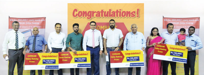 Some of the winners of the draws held in the months of September to December 2018 with Commercial Bank's Chief Operating Officer Sanath Manatunge and Head of Digital Banking Pradeep Banduwansa.