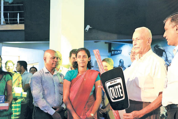 Chairman of David Pieris Group of Companies Mr David Pieris handing over the key to first Bajaj QUTE customer at the official launch at DPMC City Office in Battaramulla Launch of Bajaj Qute  Pictures by Wimal Karunathilake