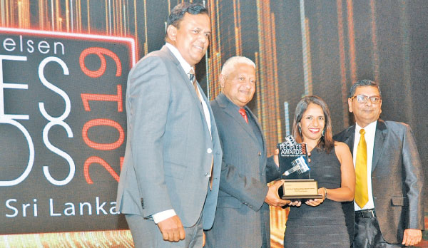 Nihal Peiris, Head of Finance, Ceylinco General Insurance accepting the award together with  Rex Gunatileke, Director and Ajith Perera, Director