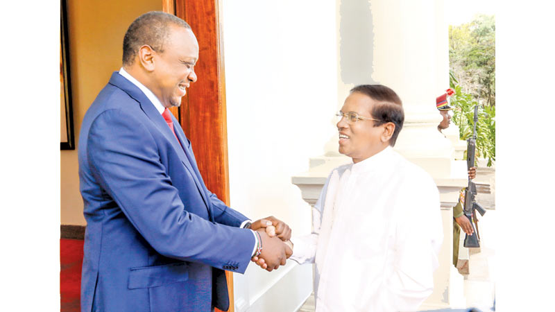 President Maithripala Sirisena who is in Nairobi, Kenya to attend the fourth session of the UN Environment Assembly being greeted by Kenyan President Uhuru Kenyatta yesterday. Picture by Sudath Silva