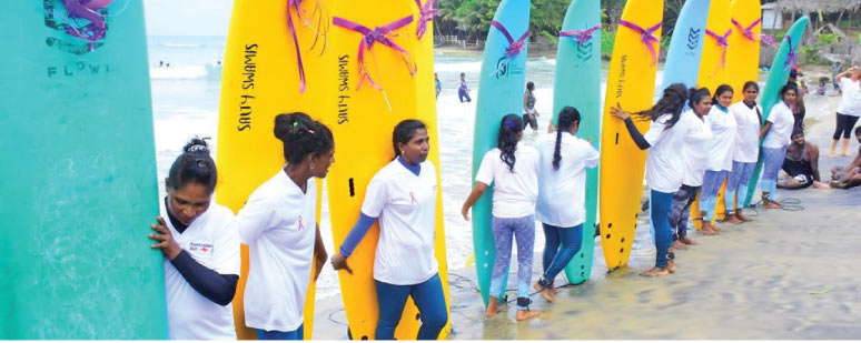 Action at the inauguration ceremony of first Women's Surfing Club in Sri Lanka at Ulle, Arugam Bay