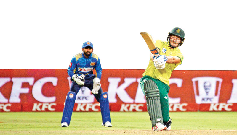 South Africa's David Miller hits a six during the Super Over in the first T20 cricket match against Sri Lanka at Newlands Stadium in Cape Town on Tuesday. - AFP