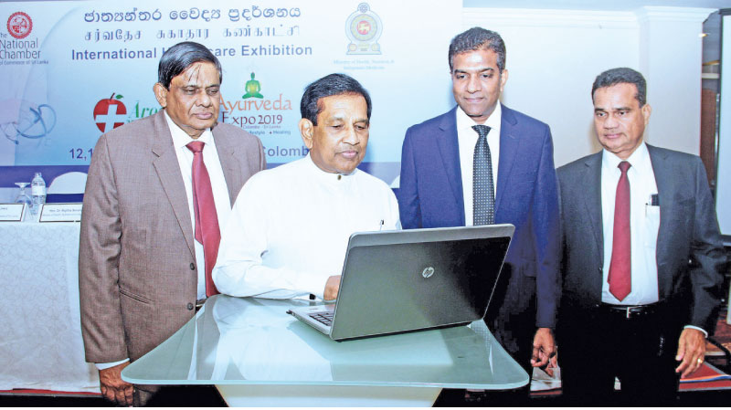 Minister of Health Dr. Rajitha Senaratne and NCCSL President Asela de Livera launching  the international Health care exhibition web. Picture by Sudath Malaweera