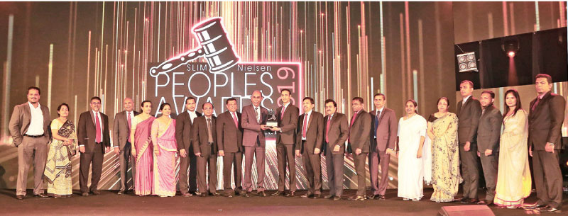 """Chief Executive Officer/General Manager Designate.  Rasitha Gunawardana of People's Bank receives the 'People's Service Brand of the Year"""" at the awards ceremony."""