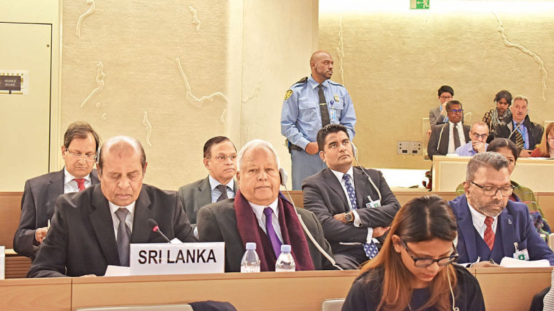 Foreign Affairs Minister Tilak Marapana PC addressing the 40th Session of the United Nations Human Rights Council (UNHRC) in Geneva on Wednesday. Minister Dr. Sarath Amunugama, Northern Province Governor Dr. Suren Raghavan, Foreign Secretary Ravinatha Aryasinha, Deputy Solicitor General Nerin Pulle and Permanent Representative Ambassador A.L.A. Azeez are also in the delegation. Picture courtesy Foreign Affairs Ministry