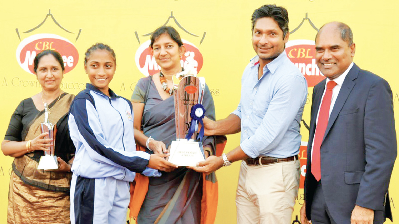 Shelinda  Jansen  of  Gateway College, Colombo  receiving  the  award  presented  to  Best Female  Athlete from  Chief  Guest  Kumar  Sangakkara  and  Guest  of  Honour  CBL Group  Managing  Director Shea  Wickramasingha.