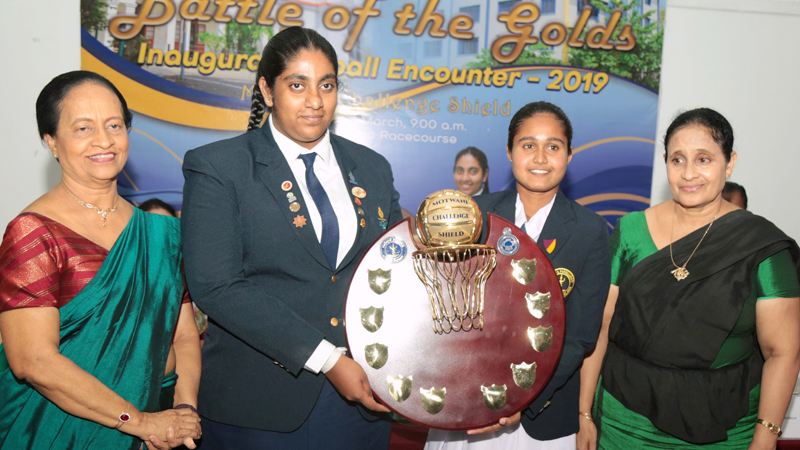 Sujatha Vidyalaya captain Lilasha Kaushalya Managoda (second from left) and skipper of Visakha Vidyalaya (third from left) pose for a picture with the Motwani Challenge Shield at a media briefing held at Sri Lanka Foundation Institute on Thursday. The Principal of Sujatha Vidyalaya Ms. Pushpa Kalubowila (extreme left) and Visakha Vidyalaya Principal Ms. Sandamali Aviruppola (extreme right) are also in the picture. Picture by Shan Rambukwella
