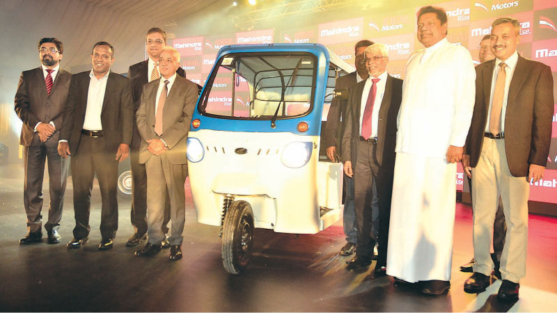 Minister Malik Samarawickrama, Deputy High Commissioner of India, Dr. Shilpak Ambule, offcials from Mahindra and Ideal Motors after launching the Treo Electric Three Wheeler. Pictures by Sudath Malaweera