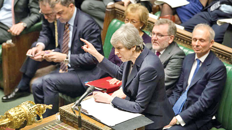 British Prime Minister Theresa May speaks at the House of Commons in London on Wednesday.