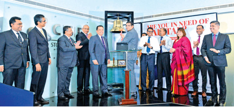 HNB PLC Chairman, Dinesh Weerakkody  ringing in the trading day at the CSE joined by (L – R) CSE Director,  Shanil Fernando, HNB Director, Madu Ratnayake, HNB Director, Nilantha De  Silva, CSE Chairman, Ray Abeywardena, HNB MD/CEO, Jonathan Alles, HNB  Chief Operating Officer, Dilshan Rodrigo, HNB Deputy General Manager –  Legal, Board Secretary, Thushari Ranaweera, HNB SME & Midmarket,  Jude Fernando, HNB Chief Human Resource Officer and Deputy General  Manager (HR), Chiranthi Cooray, HNB Chief Internal Au