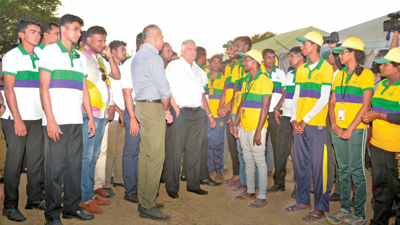 Prime Minister Ranil Wickremesinghe speaking to youths at Weerawila.