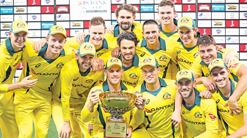 Australian players pose with the trophy  after winning the international (ODI) cricket match between Pakistan and Australia at Dubai International Stadium in Dubai on Sunday. AFP