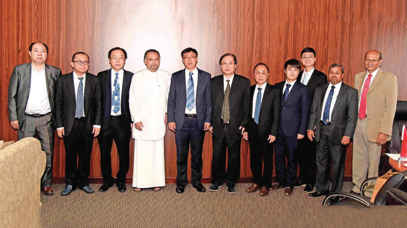 Minister of Plantation Industries, Navin Dissanayake with the visiting Hainan Group officials at the Ministry