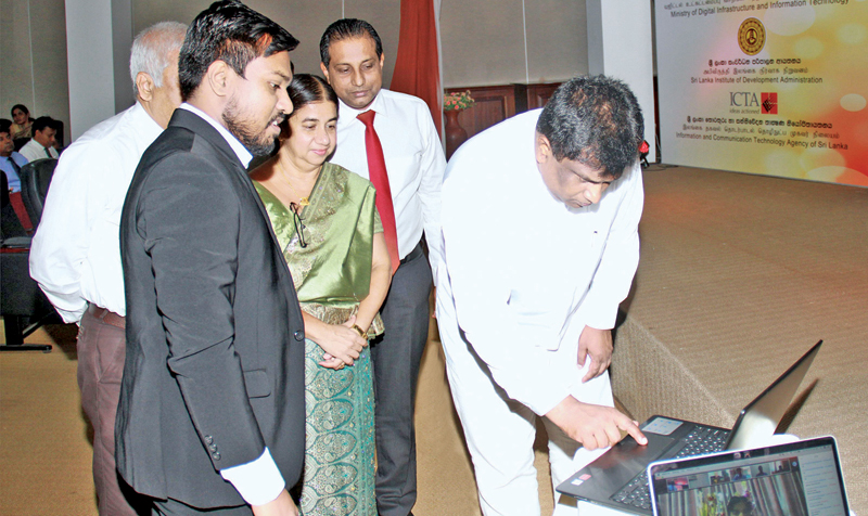 Minister Ajith P. Perera launches the Government e-Learning Platform yesterday. Picture by Shan Rambukwella