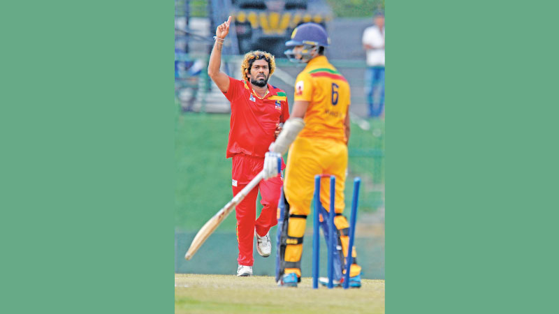 Galle CC skipper Lasith Malinga celebrates a wicket on his way to an impressive seven-wicket haul against Kandy who were shot out for 99 on the first day of the Super Four provincial limited-over tournament match at Pallekele Stadium yesterday.