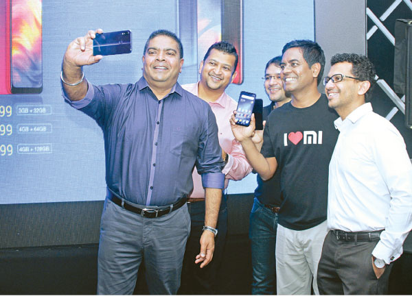 Chief Executive Officer Nalin Perera (left) taking a selfie at  the Xiaomi Redmi Note 7 launch in Colombo. Picture by Saliya Rupasinghe
