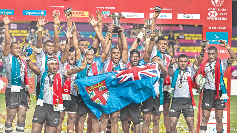 Fiji celebrate after winning the Cup final against France on the third day at the Hong Kong Sevens rugby tournament on Sunday. – AFP