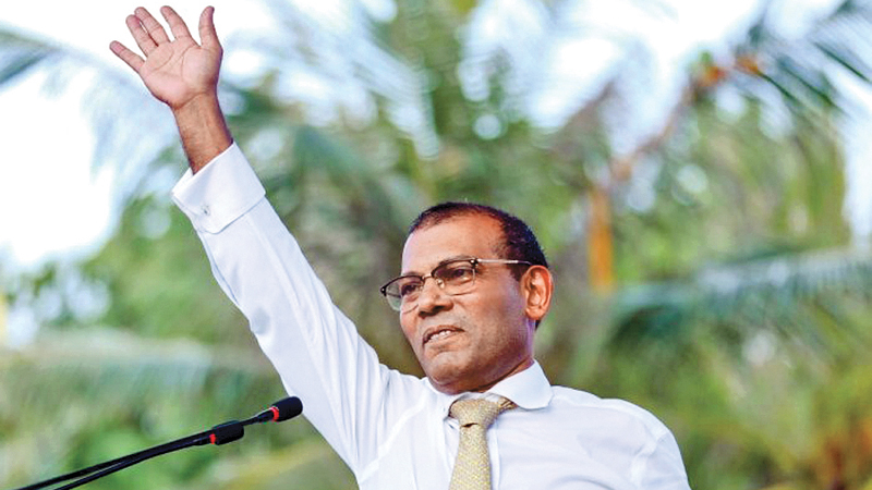 In this file photo taken on November 1, 2018 former president of the Maldives Mohamed Nasheed waves as he addresses the country after returning from exile to the Maldives.