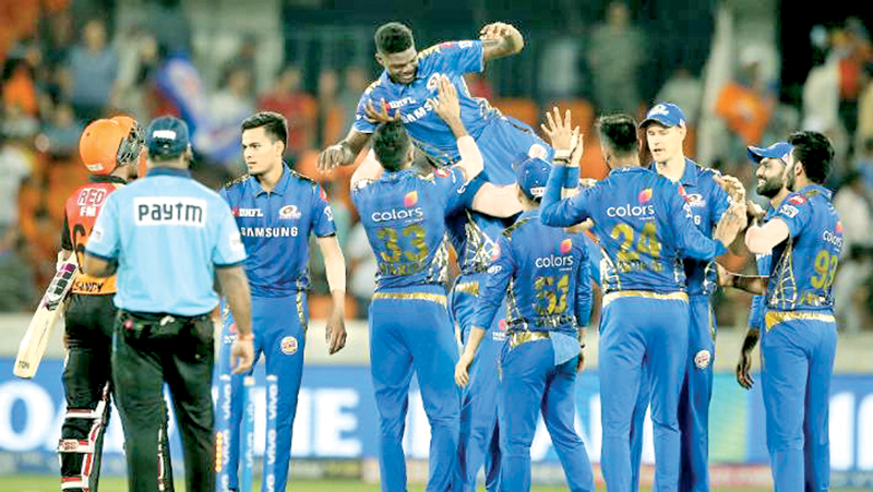 West Indies paceman Azari Joseph is lifted by his Mumbai Indians team mates after he bowled then to victory over Hyderabad Sunrisers with the best ever figures on IPL debut taking six wickets for 12 runs.