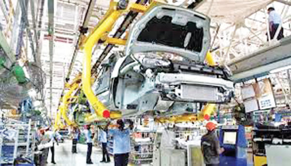 Indian workers at a car manufacturing plant