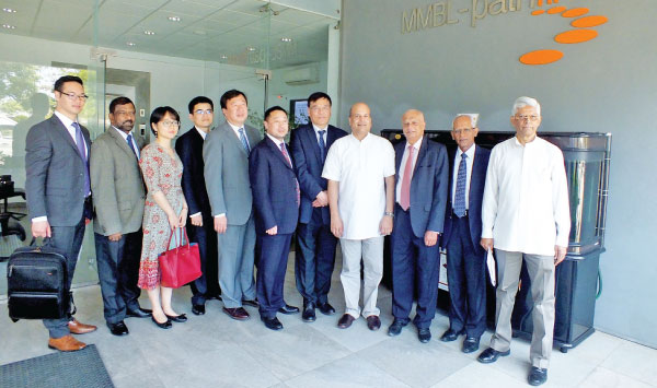 """Dr Fu Mengzi, Vice President,  Bernard Goonetilleke – Chairman Pathfinder and both team members at  the Pathfinder Foundation Office at """"Riverpoint"""""""