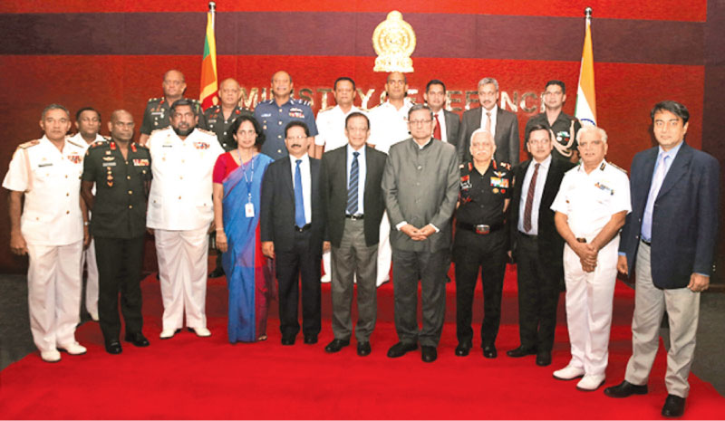 Defence Secretary Hemasiri Fernando, Indian Defence Secretary Sanjay Mitra and the Sri Lankan and Indian Defence delegations, at the meeting in Colombo yesterday.