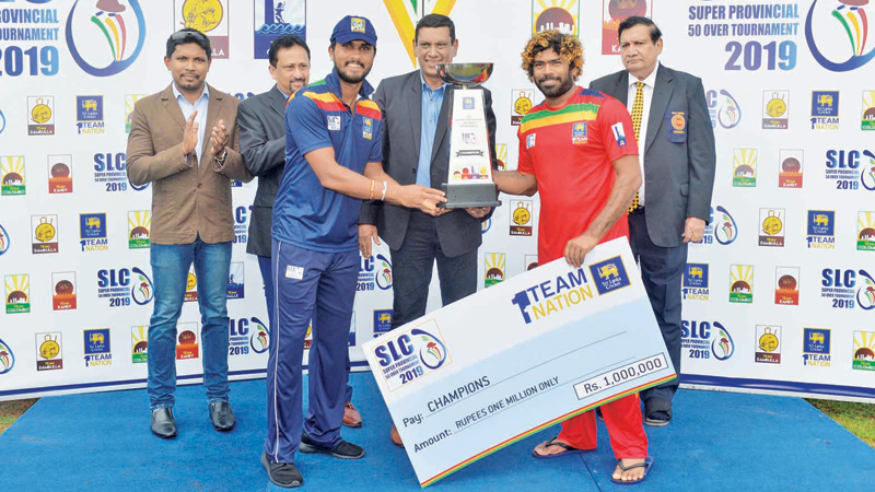 The two captains Dinesh Chandimal (Colombo) and Lasith Malinga (Galle) share the Champions trophy at the end of the Super Four Provincial limited-over final at Rangiri Dambulla Stadium yesterday.