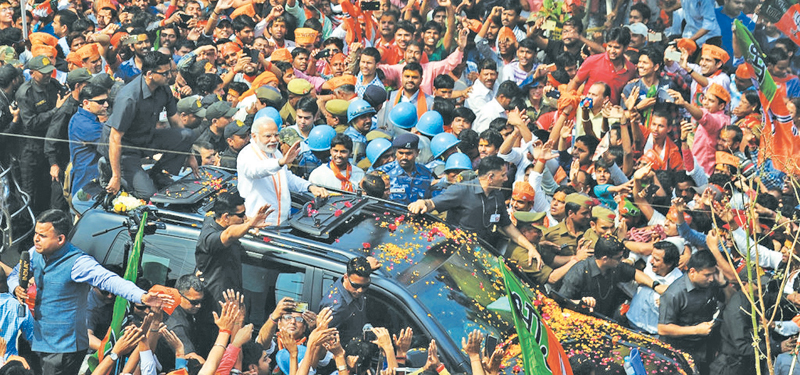 Indian Prime Minister Narendra Modi and leader of the Bharatiya Janata Party (BJP) gestures during a roadshow.