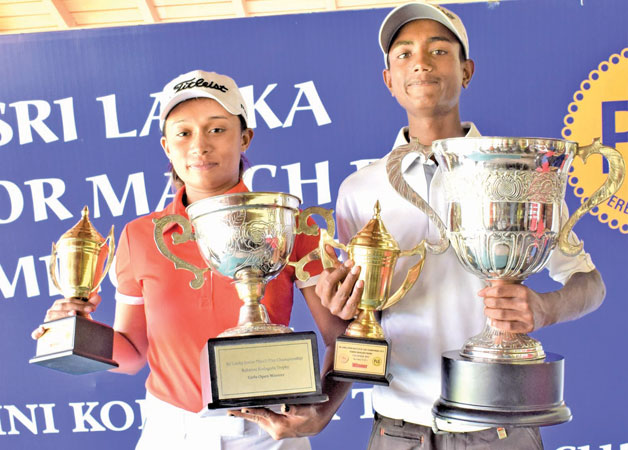 Girls Open Gold and Silver combined match play winner 3/2 Tania Balasuriya of Royal Colombo Golf Club (who was the winner last year too) with her Champions Trophy (on left), and Boys Gold winner S. Dhuwarshan of Victoria Golf Club, Nuwara Eliya with his Champion's Trophy at the awards ceremony.  (Picture by HERBERT PERERA)