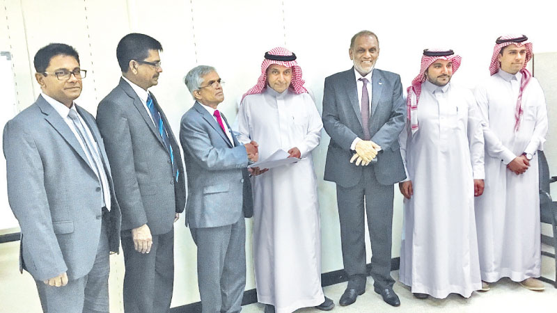 Finance Secretary R.H.S. Samaratunga exchanges documents with regard to the loan agreement with head of the Saudi delegation, Mohammed Aldolailan, in Riyadh.
