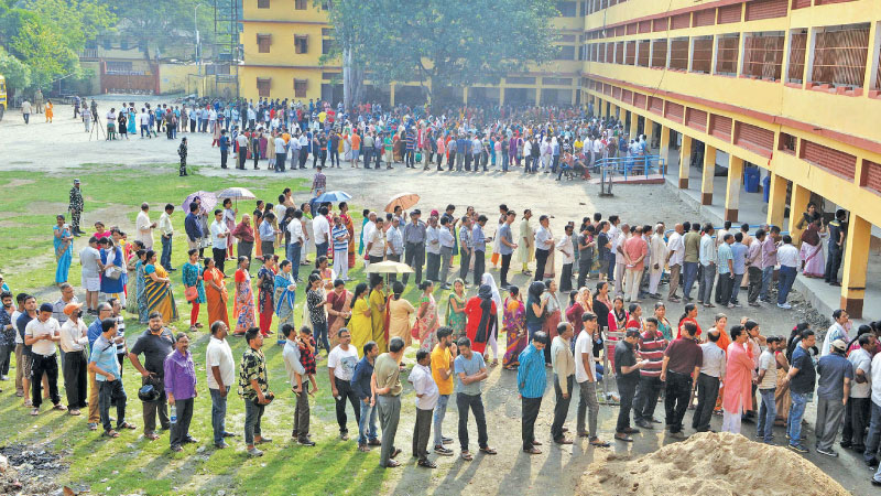 Indian voters queue up to cast their vote at a polling station in Siliguri, West Bengal yesterday, during the second phase of the mammoth Indian elections. - AFP