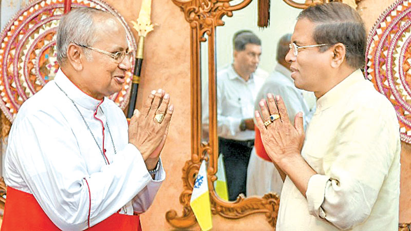 President Maithripala Sirisena yesterday called on Archbishop of Colombo Malcolm Cardinal Ranjith at   Archbishop House.  Picture by Kapila Ariyawansa