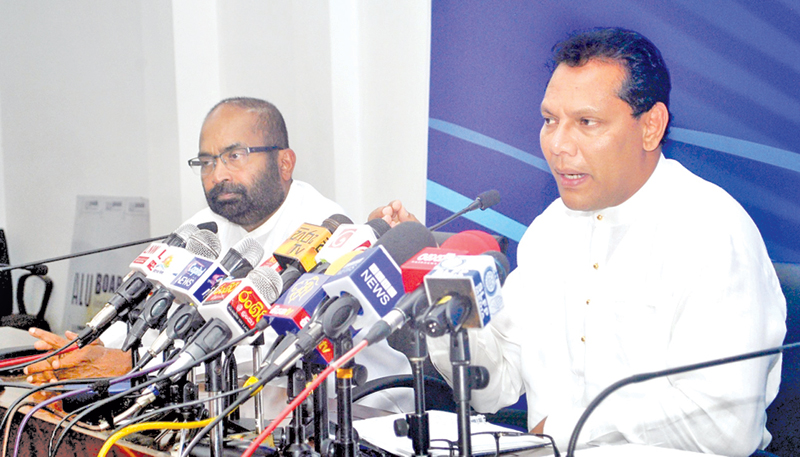 SLFP General Secretary Dayasiri Jayasekara speaks at the media conference at the SLFP Headquarters yesterday, as Parliamentarian Ranjith Siyambalapitiya looks on. Picture by Siripala Halwala