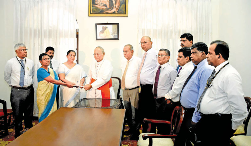 NSB officials making the donation to Archbishop of Colombo, Malcolm Cardinal Ranjith