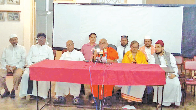 The religious leaders at the press conference.