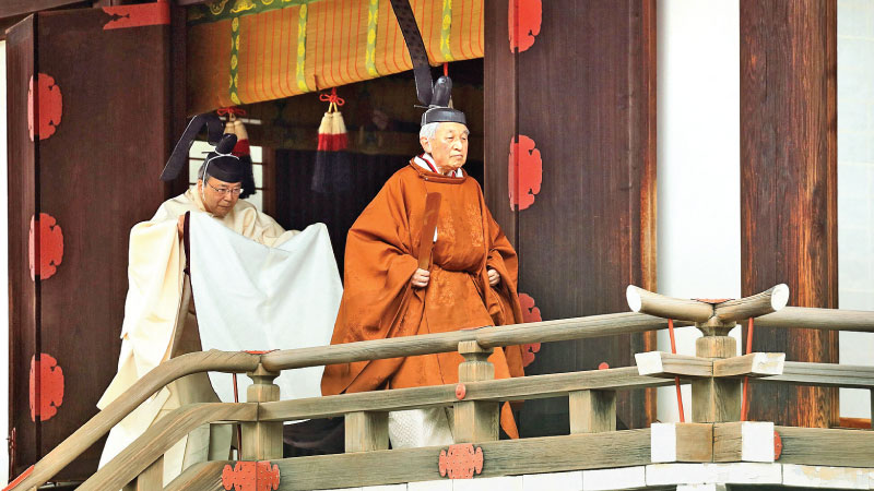 Japan's Emperor Akihito (R) leaves the Kashikodokoro imperial sanctuary inside the Imperial Palace after a ritual to report the conduct of his abdication ceremony in Tokyo yesterday. - AFP