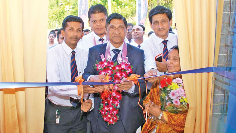 Viville Perera, Acting Chairman opening the Divulapitiya branch.