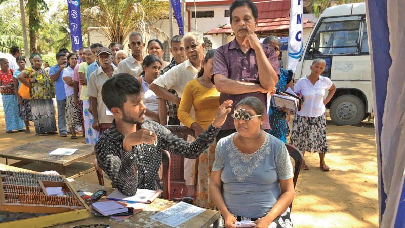Senior citizens participating at the medical and eye camp at Kataragama. SPMC  and HelpAge officials were present.